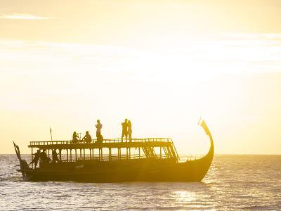 A Dhoni, a Traditional Boat, on a Sunset Cruise in the Maldives-Jad Davenport-Photographic Print