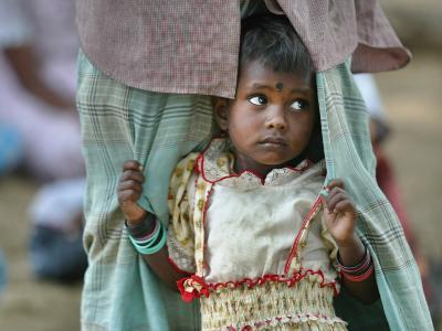 A Displaced Tamil Child Hangs to Her Father's Sarong-Gemunu Amarasinghe-Photographic Print