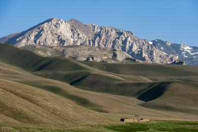 A Distant House in the Grasslands with Views of Mountains in the Distance, Bamiyan Province-Alex Treadway-Photographic Print