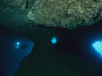 A Diver Explores an Underwater Formation Known as the Blue Hole-Tim Laman-Photographic Print