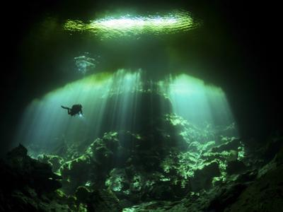 A Diver in the Garden of Eden Cenote System in Mexico