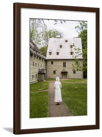 A Docent Dressed in Traditional Clothing Walks Toward the Historic Ephrata Cloister-Richard Nowitz-Framed Photographic Print