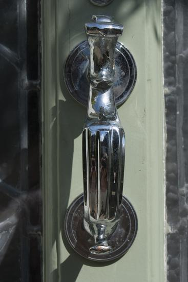A Door Knocker on a Lime Green Glass Door, of a Residential House-Natalie Tepper-Photo