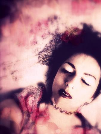 https://imgc.artprintimages.com/img/print/a-dreamy-portrait-of-a-woman-with-dark-hair-closed-eyes-and-flowers_u-l-q11ylef0.jpg?p=0