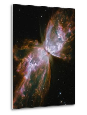 A Dying Star in the Center of the Butterfly Nebula