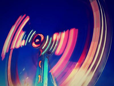 https://imgc.artprintimages.com/img/print/a-fair-ride-shot-with-a-long-exposure-at-night_u-l-q1037900.jpg?p=0