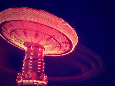 https://imgc.artprintimages.com/img/print/a-fair-ride-shot-with-a-long-exposure-at-night_u-l-q10379d0.jpg?p=0