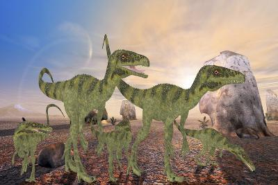 A Family of Juravenator Dinosaurs Cross a Desert Area Hunting for Prey-Stocktrek Images-Art Print