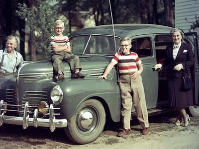 A Family Poses on and around their Plymouth Automobile, Ca. 1953