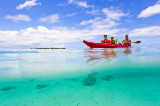 A Father and His Sons Kayaking in the Turquoise Waters Off the Coast of  Moorea Photographic Print by Mike Theiss | Art com