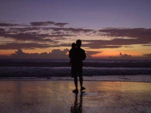 A Father and Son Enjoy Sunset by a Beach