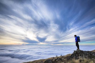 A Female Backpacker Stands On A Rocky Outcrop Above The Clouds At Steptoe Butte, Eastern Washington-Ben Herndon-Photographic Print