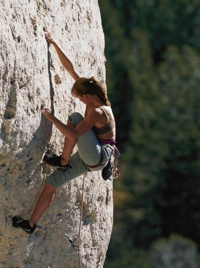 A Female Climber Searches for a Hold-Bobby Model-Photographic Print
