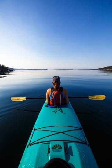 A Female Tandem Kayaker Enjoys The Still Waters Of Indian Cove Off Shaw Islands-Ben Herndon-Photographic Print
