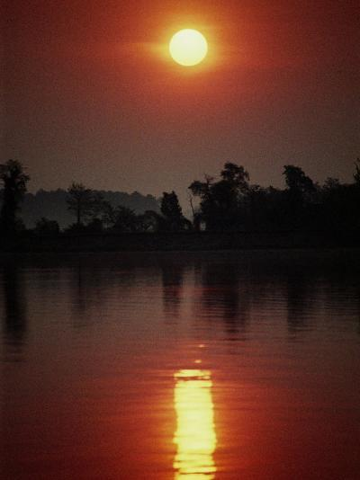 A Fiery Sun Rises Above the Tree-Lined Shore of the Wye River-Stephen St^ John-Photographic Print