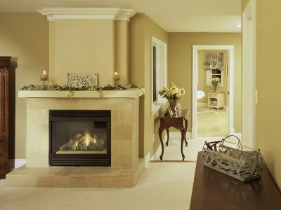 A Fire in the Fireplace and Candles on the Mantle--Photographic Print