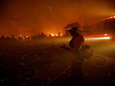 A fireman watches flames advance down a hill toward local businesses-Mark Thiessen-Photographic Print