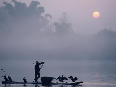 A Fisher Uses Cormorants to Capture Fish from the Li River at Sunrise-Kenneth Ginn-Photographic Print