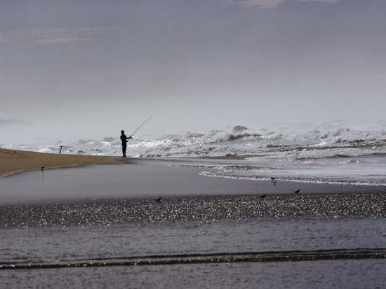 A Fisherman Casts His Line into the Surf-Marc Moritsch-Photographic Print