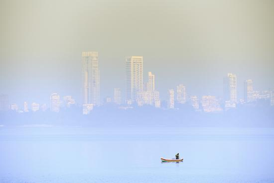A Fisherman in Front of the Skyscrapers of the Malabar Hills in Mumbai (Bombay), Maharashtra, India-Alex Robinson-Photographic Print