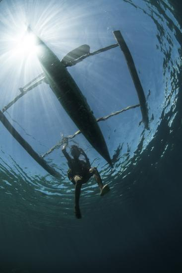 A Fisherman Uses a Wooden Outrigger Near a Remote Island in Indonesia-Stocktrek Images-Photographic Print