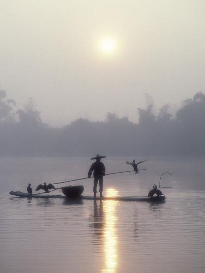 A Fisherman Uses His Cormorants to Catch Fish in the Early Morning-Kenneth Ginn-Photographic Print