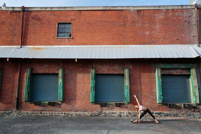 https://imgc.artprintimages.com/img/print/a-fit-blonde-woman-does-yoga-in-front-of-an-old-brick-warehouse-in-downtown-spokane-washington_u-l-q19nzo10.jpg?p=0