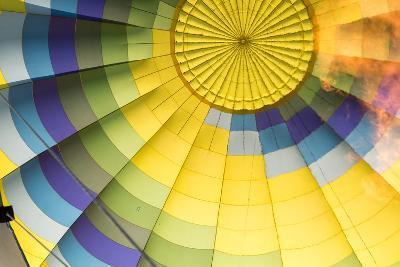 A Flame Is Visible Inside a Colorful Hot Air Balloon-Eric Kruszewski-Photographic Print