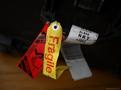A Fragile Tag is Shown Hanging on a Piece of Baggage-Stephen Alvarez-Photographic Print