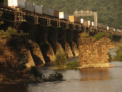 A Freight Train Crosses the Rockville Bridge-Raymond Gehman-Photographic Print