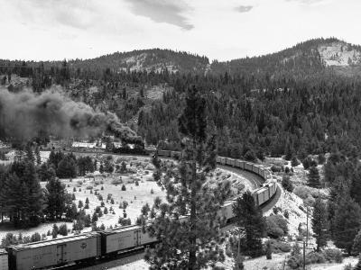 A Freight Train Traveling around a Sharp Curve--Photographic Print