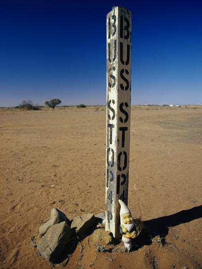 A Garden Gnome at a Bus Stop in an Outback Desert Town-Jason Edwards-Photographic Print