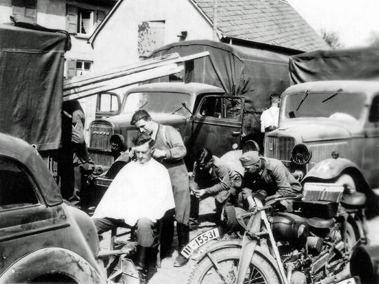 A German Soldier Is Getting a Haircut, France, 1940--Photographic Print