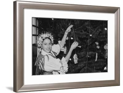 A Girl Decorating One of the Many Ethnic Themed Trees During the Annual Christmas around the World--Framed Photographic Print