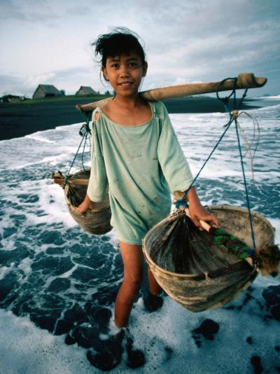 A Girl Gathers Salt Water in Lontar Leaf Buckets for Salt Making, Kusamba, Indonesia-Adams Gregory-Photographic Print