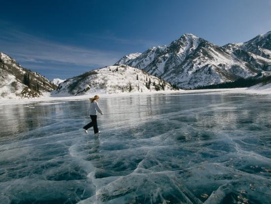A Girl Ice Skates Across a Frozen Mountain Lake-Michael S^ Quinton-Photographic Print