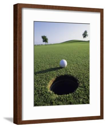 A Golf Ball Just Short of the Hole
