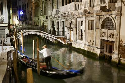 A Gondolier in a Quiet Canal At Night in Venice, Italy-Ira Block-Photographic Print