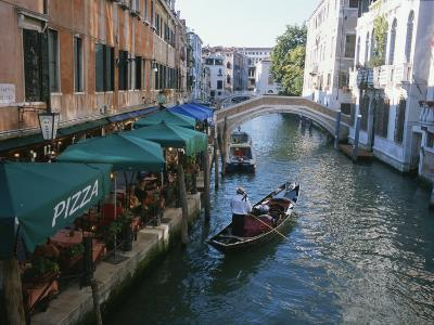 A Gondolier Passes a Restaurant on a Canal in Venice, Italy-Taylor S^ Kennedy-Photographic Print