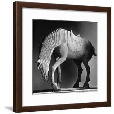 A grazing horse. China, thought to be Six Dynasties,c.AD220-580-Werner Forman-Framed Giclee Print