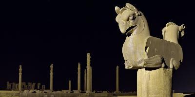 A Griffin Statue, or Homa Bird, with Apadana Palace Columns in the Distance-Babak Tafreshi-Photographic Print