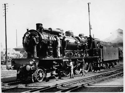 A Group of British Railway Engineers Carrying Out Safety Checks a Steam Locomotive--Photographic Print