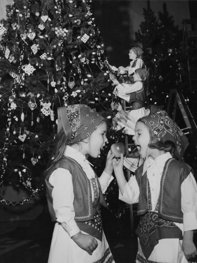 A Group of Children Decorating the Croatia Tree During the Annual Christmas around the World Festiv--Photographic Print