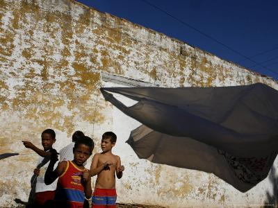 A Group of Children Fly Plastic Bags, Known as Papalotes-Javier Galeano-Photographic Print