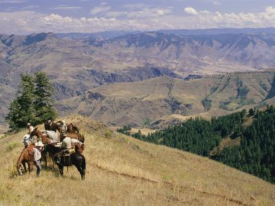 A Group of Horseback-Riding Tourists Take in the View of Hells Canyon-Richard Nowitz-Photographic Print