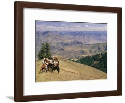 A Group of Horseback-Riding Tourists Take in the View of Hells Canyon-Richard Nowitz-Framed Photographic Print