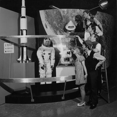 A Group of People Pose on a Ladder in Front of the NASA Apollo Exhibit--Photographic Print