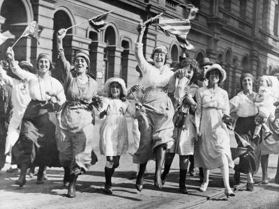 A Group of Women and Children Rejoicing in a Street in Sydney at the Signing of the Armistice--Photographic Print