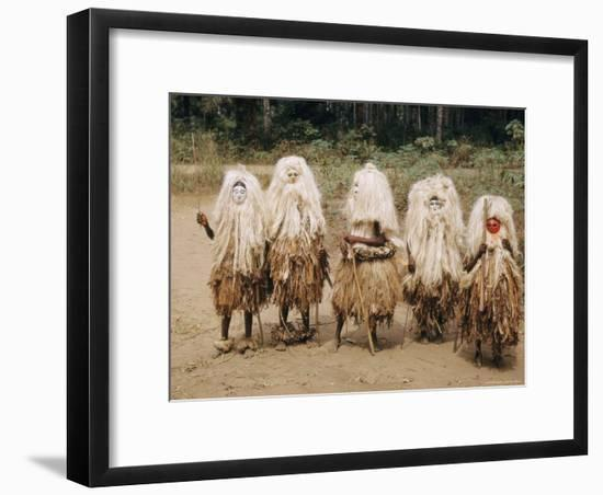 A Group of Young Boys in a Masked Dance-W. Robert Moore-Framed Photographic Print