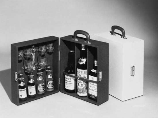 A Handy Case Containing Whisky, Martini and Gin, Mixers, a Bottle Opener and Glasses!--Photographic Print